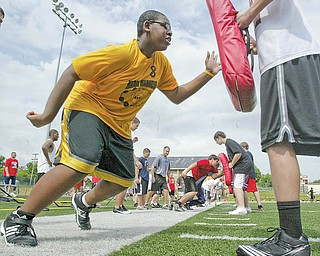 Ted Everett, 13, of Youngstown was one of hundreds of young football players attending a camp at Cardinal Mooney High School on Monday.
