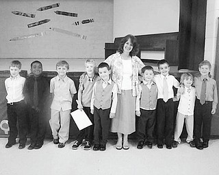 Students are upgraded Members of the kindergarten class at St. Patrick School in Hubbard were honored by family, friends, staff and fellow students during a graduation ceremony recently at the school. Each student was escorted by an eighth-grade buddy who presented each with a book containing a story about things they learned about their kindergarten friend during the year. The graduating youngsters were joined by their teacher, Mrs. Barbara Bond, as they lined up to receive their diplomas and to sing special songs at the event. A reception followed the ceremony.