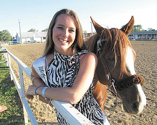 Elaine Kelley, 17, of Cortland, stands with one of her two horses, Padamay, with whom she will compete in Columbus July 30 in contesting events. Five weeks ago, another horse, Rebel, fell on her, injuring her face, shoulder, arms and legs, but she decided to compete anyway in her horse riding events two weeks ago and the Miss Trumbull County Fair contest June 28, finishing second in the queen contest and qualifying for a horse riding contest in Columbus.