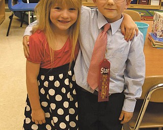 Joshua Colvin and his friend, Alexis Duvall, graduated from kindergarten at Taft Elementary School in Youngstown on June 7.