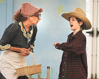 "Mrs. McGregor, played by Molly Galano of Boardman, confronts Peter Rabbit, portrayed by Donny Wolford of Greenford, during a production of ""Miss Beatrix Potter Presents Peter Rabbit"" at the Poland branch of the Public Library of Youngstown and Mahoning County."