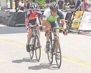 BIKE RACE - The leaders draft down the straight away downtown Youngstown Sunday afternoon. - Special to The Vindicator/Nick Mays