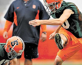 Bob Casullo watches the ball after a kick by place-kicker Jake Smith.. Photo by Frank Ordo–ez /The Post-Standard