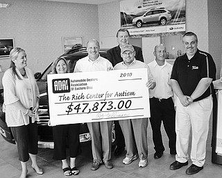 The Automobile Dealers Association of Eastern Ohio raised $47,873  for The Rich Center for Autism at Youngstown State University. The check for the record-breaking donation was presented July 7 at Boardman Subaru. Present for the ceremony were, from left to right, Tricia Perry and Phyllis Ricchuti, both of the Rich Center; Rob Fellman, chairman and new ADAEO board president, of Boardman Subaru; Steve Chos, executive vice president of the ADAEO; John Kufleitner of Columbiana Chrysler, Jeep Dodge; and Tom Levak and Steve Bott of Mark Thomas Ford.