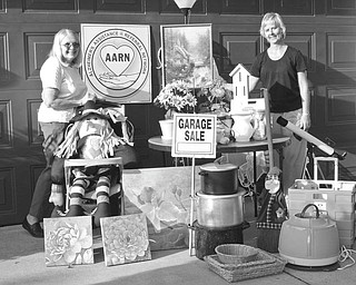 Alzheimer's Assistance and Referral Network is having a garage sale from 9 a.m. to 3 p.m. Thursday and Friday, and from 9 a.m. to 11 a.m. July 24 at Western Reserve United Methodist Church, 4580 Canfield Road, Canfield. Arranging some of the items to be featured at the sale are, at left, Dorothy Barto, director of AARN, and Mary Kay Kollat, volunteer coordinator. Proceeds will benefit the network. Donations of clean, salable items will be accepted from 9 a.m. to 3 p.m. Tuesday and Wednesday at the church.
