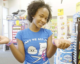 Above left, Daria Wansley, 13, of Columbus, shows off her Silly Bandz at CVS, 6121 South Ave. in Boardman. Silly Bandz are made of silicone and die-molded into a variety of shapes. The rubber bands return to their original shape when you take them off . She and her cousin were shopping with Alyssa's mother and Daria's aunt, Tammye Hardin of Youngstown.