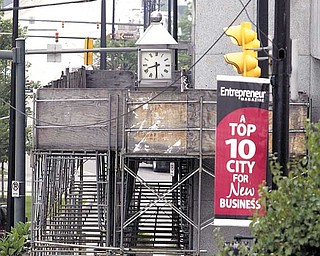 A  downtown Youngstown building still has scaffolding around it two years after it was erected. .