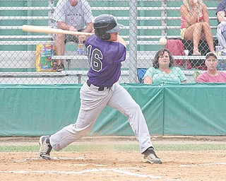 Dave Sugar Excavating centerfi elder Alex Miklos keeps his eye on the ball during his at-bat in Tuesday's game.