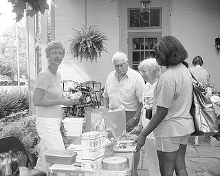 Browsing for bargains: Customers at the annual Upton Garage Sale, in downtown Warren, browse through the goods. The Upton Association and the Trumbull County Historical Society are sponsoring the sale, which is open to the public. It will take place from 9 a.m. to 4 p.m. Friday and Saturday. Tools, toys, furniture, antiques and household items are always available at the sales. Donations will be accepted from 9 a.m. to noon today and from 2-5 p.m. Thursday. The Harriet Taylor Upton Association, 380 Mahoning Ave. NW, Warren, operates Upton House. For more information phone 330-395-1840 or visit www.uptonhouse.org on the Web.