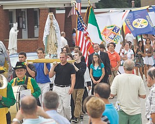 The 12th Annual Procession for the Our Lady of Mount Carmel Italian Festival proceeds down Via Mount Carmel Avenue.
