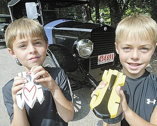 The event also boasts an All-County Pinewood Derby Race for children. Brothers Collin, 7, left, and Zack Schick, 9, show off their winning cars from an earlier race. They are the sons of Jon and Bobbie Schick of Canfield. The competition is open to boys and girls age 5 to 17.