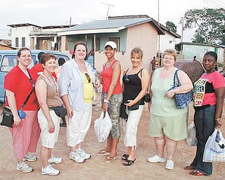 Local nurses, known as the Dream Team, visited a village with other guests while on a medical mission to Ghana led by Dr. Michael Obeng, head of plastic and reconstructive surgery at St. Elizabeth Health Center in Boardman. From left, Angela Lee of Mineral Ridge, Roberta Hamilton of Hubbard, Glenda Bell-Golec of Poland, Tatiana Blanchard, a medical student from Florida, Kathleen Fimognari of Poland, Juanita Combs of Boardman and Joyce Obeng, Dr. Obeng's sister, of Ghana.