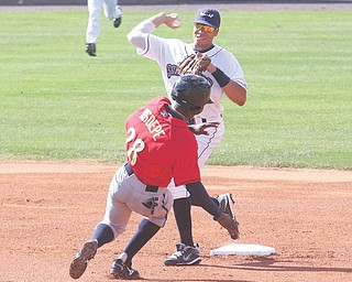 Scrappers infielder Aaron Fields fi res to first base as Spikes baserunner Gift Ngoepe tries to break up the play in Sunday's game at Eastwood Field in Niles.