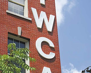 The YWCA showcased the  $10 million renovation of its nearly century-old building at 25 W. Rayen Ave., Youngstown, with the first 10 of 30 apartments having been completed there in mid-July. The project also includes renovations to the first floor, which will likely feature an Internet cafŽ, and installation of a new roof.