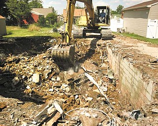 A blighted house at 497 Sexton St. is demolished, to the delight of the neighbors. Pusateri Excavating of East Liverpool tore down the house Tuesday.