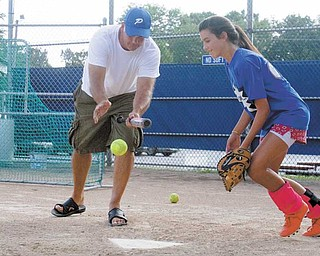 Poland's Dani Rutana, right, practices fi elding a bunt hit by coach Chuck Masluk during practice North Elementary fi elds on Tuesday. Poland's 11-12 softball all-stars play in the Little League Central Region tournament in Carthage, Mo., starting Saturday.