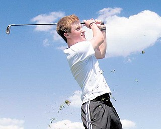 Dan Lageson, 18, of Howland, tees off at Parto's Golf Learning Center. Lageson visited the course for the first time after coming across somecoupons.
