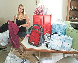 Nicci Dunkerton of Bristolville packs up in preparation for her freshman year at Hiram College.