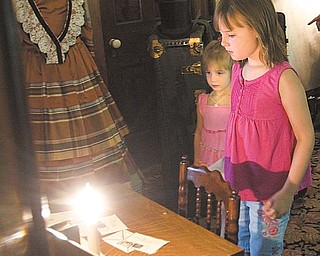 Megan, 3, and Meredith Blair, 8, of Mineral Ridge explore the upstairs master bedroom at the Ward-Thomas Museum during Heritage Day.