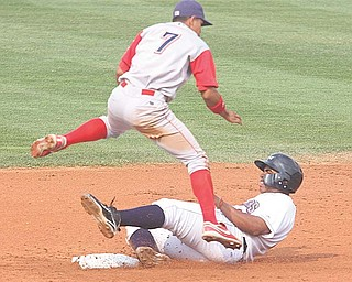 Williamsport's Ceasar Hernandez (7) leaps over Mahoning Valley's Jesus Aguilar as Aguilar tries to break up a double play during Sunday's game at Eastwood Field in Niles. The Scrappers lost their second game in as many nights to the Crosscutters, who won 5-3.
