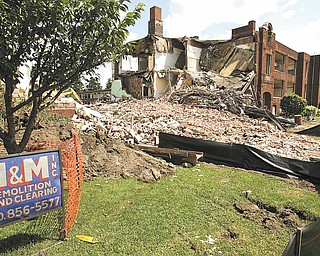 Demoliton has begun on the old Jackson-Milton High School, built in 1913. It's on Mahoning Avenue across from Spitzer Chevrolet near state Route 45 in Jackson Township. Crews from M&M Demolition Inc., Vienna, said it should take about a month to complete the job.