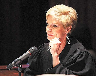 Judge Maureen Sweeney of the Mahoning County Common Pleas Court listens at the arraignment of defendants charged in the county corruption case related to the Oakhill Renaissance Center purchase. None of the defendants attended the arraignment; their attorneys submitted documents before the Tuesday court proceeding with not-guilty pleas on behalf of their clients.