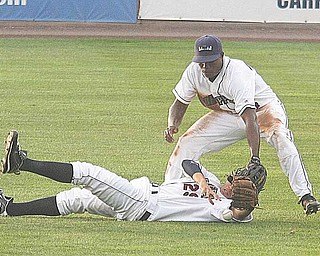 Aaron Fields, on ground, and Carlos Moncrief of the Mahoning Valley Scrappers chase a loose ball during Wednesday's game against the Tri-City ValleyCats at Eastwood Field.
