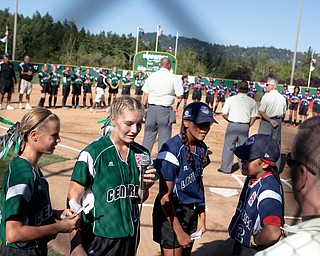 Players from each team recite the LIttle League pledge during the 2010 World Series of Little League Softball, Central vs. Latin America. Central went on to win the game, 7-4.