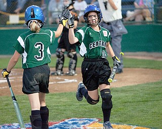 Claire Testa (3) and Maddie Rowe (12) high-five during the World Series of Little League Softball in Portland, Ore., July 13th, 2010. The team from Poland, OH went on to beat the team from Brenham, TX, 5-4.