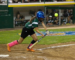 Dani Rutana connects with a solid bunt during the World Series of Little League Softball in Portland, Ore., July 13th, 2010. The team from Poland, OH went on to beat the team from Brenham, TX, 5-4.