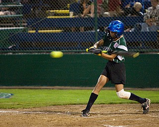 Abby Masluk swings at a fastball during the World Series of Little League Softball in Portland, Ore., July 13th, 2010. The team from Poland, OH went on to beat the team from Brenham, TX, 5-4.