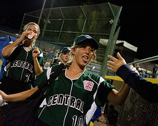 Cara Kalouris gets a congratulatory high-five after her team wins their first game at the World Series of Little League Softball in Portland, Ore., July 13th, 2010. The team from Poland, OH beat the team from Brenham, TX, 5-4.
