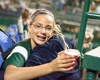 Kristyn Svetlak gets a congratulatory hug after her team wins their first game at the World Series of Little League Softball in Portland, Ore., July 13th, 2010. The team from Poland, OH beat the team from Brenham, TX, 5-4.