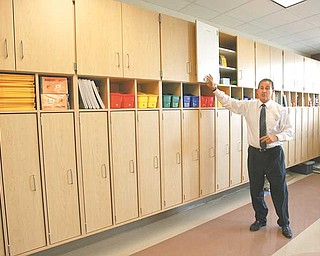 Superintendent Dennis Dunham shows off one of the many storage areas in the elementary wing at the new South Range school building. There are separate wings for middle and high school students. School starts Sept. 8.