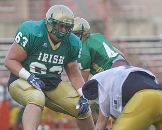 LISA-ANN ISHIHARA | THE VINDICATOR...Ursuline Zach Conlan #63 blocks his QB Paul Kempe #4 during scrimmage game against Canton GlenOak Eagles