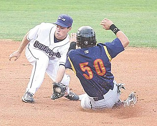 Scrapper shortstop Nick Bartolone, left, tags out Adalberto Santos of the State College Spikes, who was attempting to steal second base, in Tuesday's New York-Penn League game at Eastwood Field.