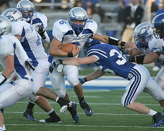 ROBERT K. YOSAY | THE VINDICATOR..HUBBARD @ POLAND -  Hubbards #6    Michael Lupuchovsky   tries to break the tackle of Poland #36  Hochendoner  as  he get talckled behind the line.-30