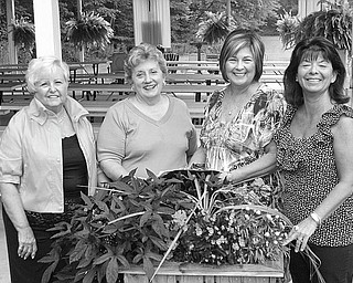"""Making luncheon arrangements: """"All That Jazz"""" has been chosen as the theme for the 41st annual Champagne Luncheon to be sponsored by GFWC/Warren Junior Women's League on Nov. 19 at the Holiday Inn MetroPlex in Liberty. Making arrangements for the fundraiser are committee members, from left, Carol Giffiths, invitations; Dorothy Sideropolis, club president; Mary Lou Jarrett, luncheon; and Renee Maiorca, reservations. Proceeds from the event will help to support the Children's Rehabilitation Center's Scholarship Fund, so no child will have to be turned away because of his or her inability to pay for needed physical, developmental and speech therapy. For more information on the luncheon, call Maiorca at 330-638-7322 during the day or at 330-637-8991 after 6 p.m."""