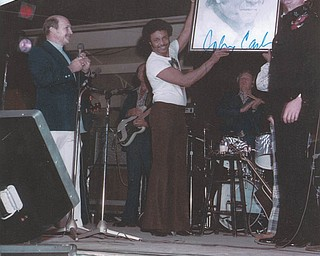 Chuck Cavanaugh of New Middletown submitted this Canfield Fair memory. Johnny Cash's band leader, Bill Dotson, is presenting Cash with a portrait he drew of him in 1968. Cavanaugh got Cash to autograph the drawing.