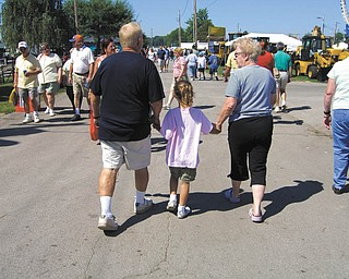 Hailey Kadivar of Bradenton, Fla., walks with her grandparents, Bob and Joan Stroh of Poland.