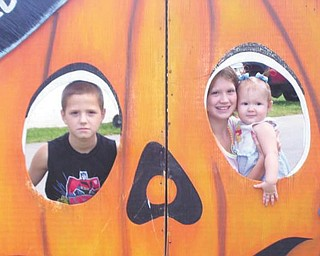 Michael, left, Sierra and Chelsea Campbell of Youngstown attended the 2009 Canfield Fair.
