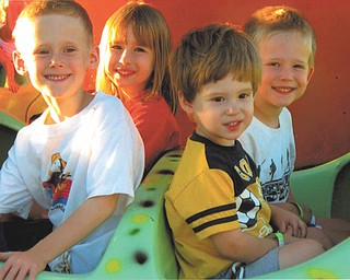 Brothers Ryan, Jason and Evan Sweder, 6, 5 and 3, of Poland and their cousin, Riley Sweder, 6, of Columbus are shown enjoying Kiddie Land.