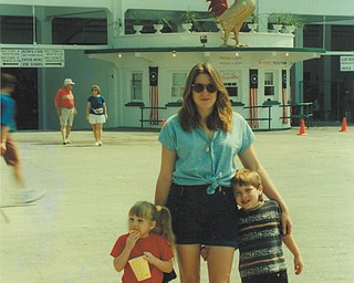 Heidi Van Auker Hartsough of Canfield are with her children, Leanna and Aaron, at the 150th Canfield Fair in 1996.