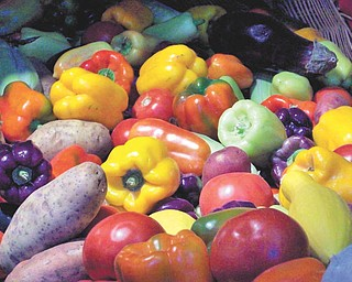 An assortment of veggies make a colorful display at the Canfield Fair. Photo by Annette McCarthy.