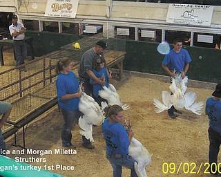 Jessica and Morgan Miletta of Struthers show off their turkeys. Morgan's turkey won first place.