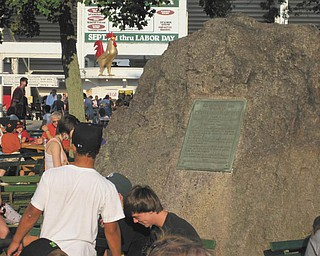 People gather near The Rooster and The Rock to meet at the 2009 Canfield Fair. Photo submitted by John Simpkins.