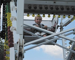 Bryson Nichols of Austintown has fun on the kiddie Ferris wheel at the 2009 fair. Photo sent in by John Simpkins.