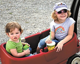 Brienna, left, and Natalie Kollar of Hudson, Ohio, enjoy a wagon ride. The photo was submitted by their grandmother, Elaine Kollar of Lowellville.