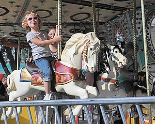 Natalie Kollar of Hudson, Ohio, rides the merry-go-round as her mother, Kathy, watches. Photo submitted by Elaine Kollar of Lowellville.