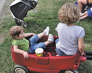 Brienna, left, and Natalie Kollar of Hudson, Ohio, relax in their wagon. The photo was submitted by their grandmother, Elaine Kollar of Lowellville.